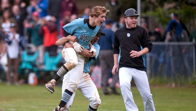 South Burlington's Sam Premsagar, center, hugs Andrew Cunningham after Cunningham's walk-off single gave the Wolves a 5-4 win over St. Johnsbury in the Division I high school baseball semifinals on Tuesday at South Burlington.