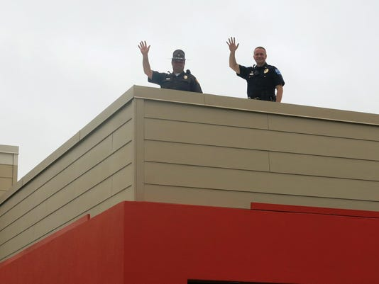 636488631131241372-waving-from-the-roof.jpg