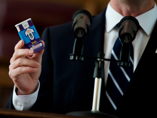 Mark Herzog, Kaleo Corporate Affairs vice president, holds up an Evzio injector during a press conference about a grant to give out anti-opioid injectors to first responders on Wednesday, May 2, 2018, in Montgomery, Alabama.