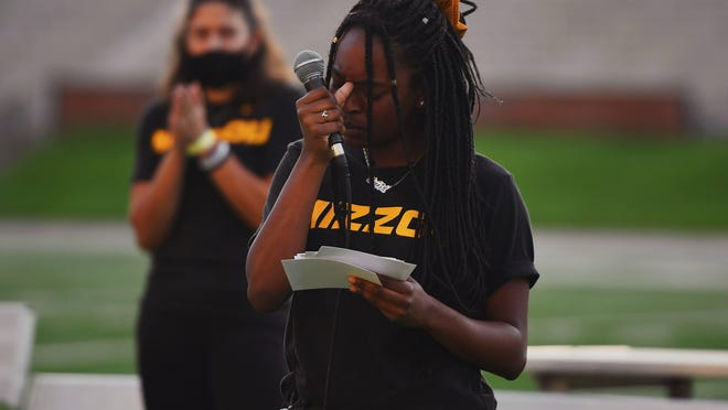 MU soccer player Keiarra Slack pauses as she speaks to the crowd during a sit-in at Faurot Field on Sept. 2.