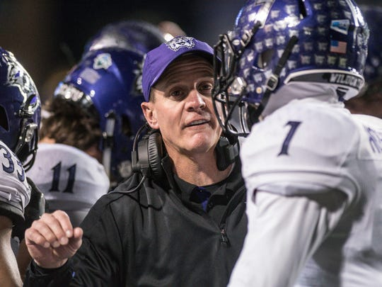 Weber State coach Jay Hill talks with safety Trey Hoskins (7) during the first half against James Madison in an NCAA college football game in the quarterfinals of the FCS playoffs Friday, Dec. 8, 2017, in Harrisonburg, Va. (Daniel Lin/Daily News-Record via AP)