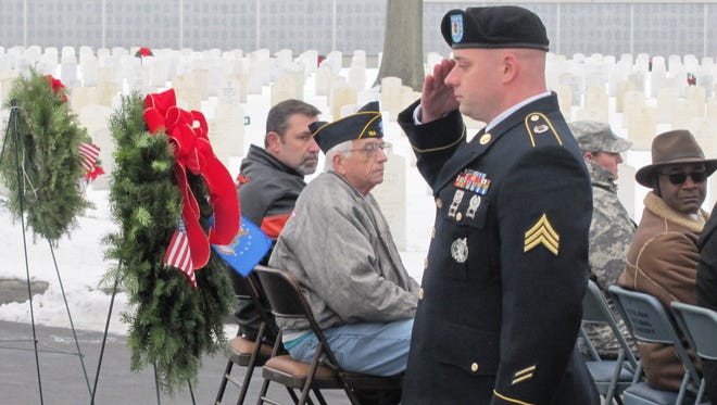 Seven wreaths were presented to each branch of the military, including one for those who were prisoners or war or missing in action, during Saturday's Wreaths Across America event at Woodlawn National Cemetery in Elmira.