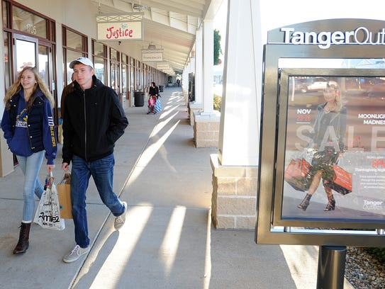 Black Friday shoppers get out early on a chilly morning looking for bargains at the Tanger Outlets near Rehoboth Beach on Friday, Nov. 24.