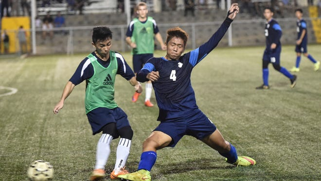 The Harvest Christian Academy Eagles played the St. Paul Warriors in an IIAAG Boys' Soccer League semifinal playoff match at the Guam Football Association National Training Center in Harmon on Dec. 16.