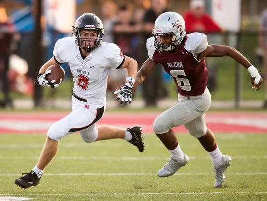 Maryville's Christian Markham is pursued by Alcoa's