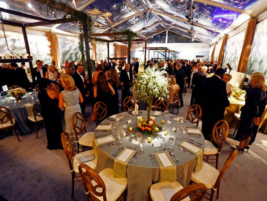 Guests are seated in the dinner tent at the Frist Gala
