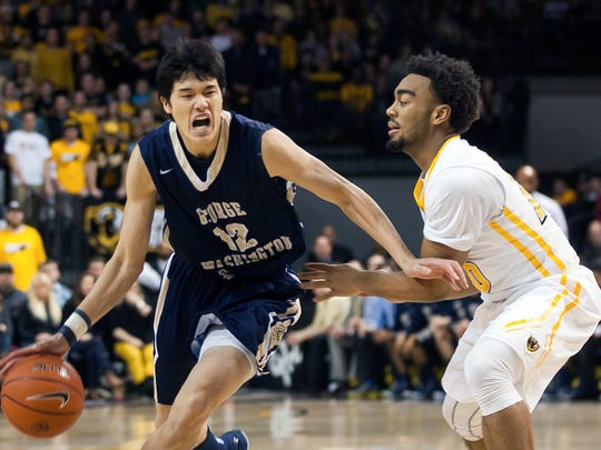 George Washington forward Yuta Watanabe, left, drives around VCU guard Jonathan Williams, right, during an NCAA college basketball game at the Siegel Center in Richmond, Va., on Tuesday, Jan. 27, 2015.