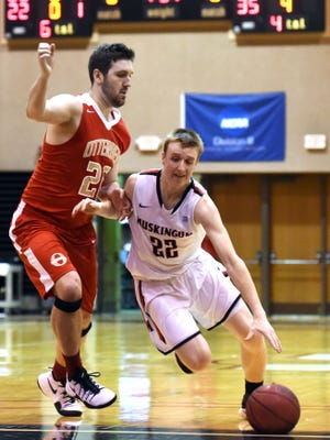 Tri-Valley grad Marcus Dempsey, of Muskingum, drives into the lane against Otterbein.