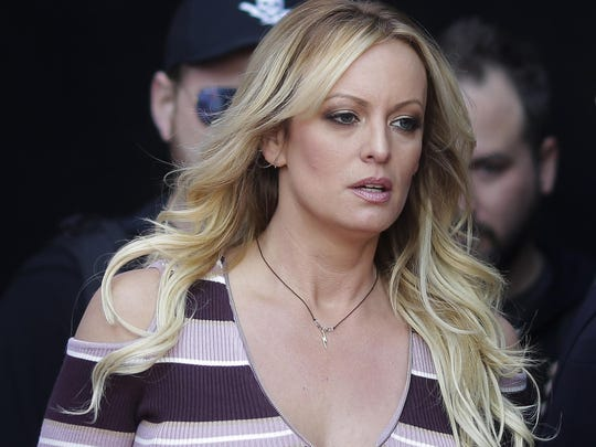 """In this Oct. 11, 2018, file photo, adult film actress Stormy Daniels arrives for the opening of the adult entertainment fair """"Venus"""" in Berlin. Daniels has sued the Columbus police department for $2 million over her arrest at a strip club last summer. The federal defamation lawsuit filed Monday, Jan. 14, 2019, alleges officers conspired to retaliate against Daniels for her sex allegations concerning Donald Trump before he became president."""