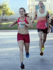 Melissa Gacek is the first female to cross the finish line during the 35th annual Turkey Trot 5K in Cape Coral on Thursday.