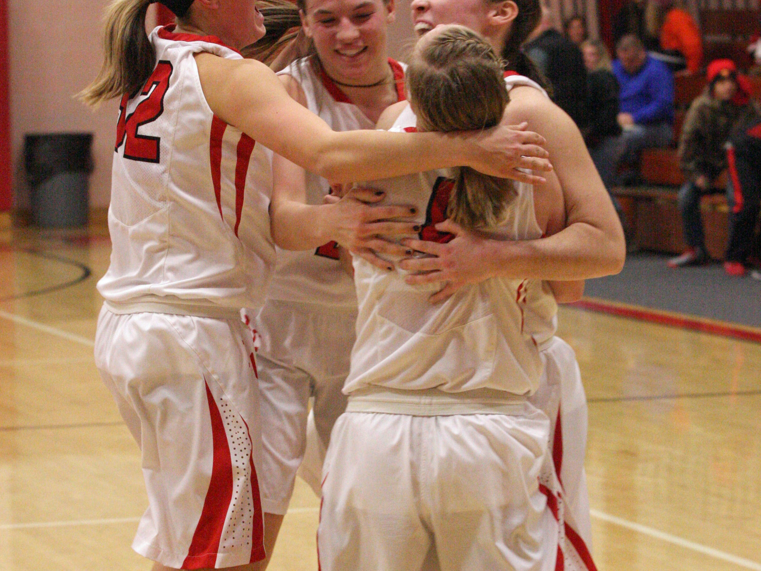 Sydney Alexander, Bethany Urban and Emily Ashley, left to right, and Hannah Weaver, front, celebrate Port Clinton's victory Saturday over Clyde.