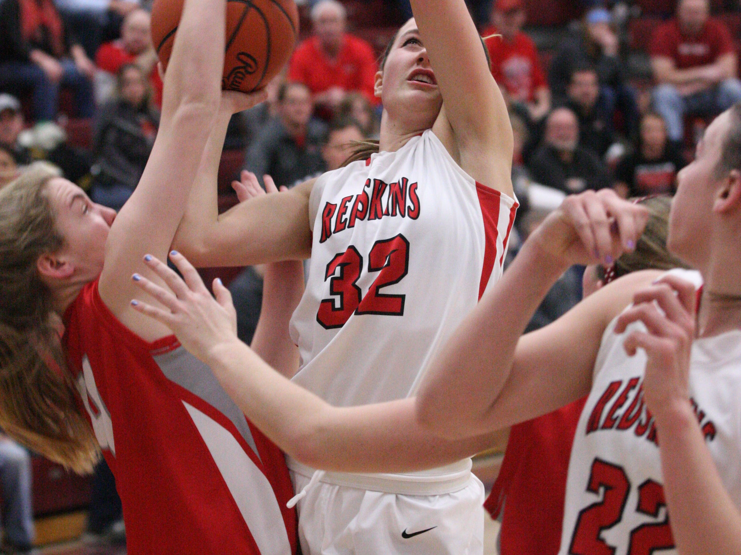 Port Clinton's Sydney Alexander is fouled by Bowling Green's Ally Hart-Nichols while trying to power up a shot Saturday.