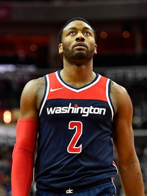 Washington Wizards guard John Wall (2) on the court against the Brooklyn Nets during the second half at Capital One Arena.