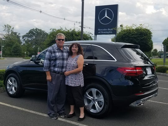 Last year's hole-in-one winner of the YMCA's Annual Golf Classic, Bob Gill, who took home a 2017 GLC300W4 from Flemington Mercedes. On the right is his wife, Kate Gill.