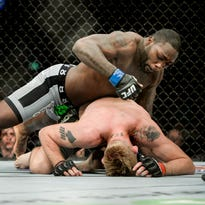 """Anthony """"Rumble"""" Johnson, top, of the US fights with Alexander """"The Mauler"""" Gustafsson of Sweden in their UFC light heavyweight mixed martial arts bout at Tele2 Arena in Stockholm, Sweden, on Saturday, Jan. 24, 2015. (AP Photo/TT, Jessica Gow)  SWEDEN OUT   ORG XMIT: STO817"""