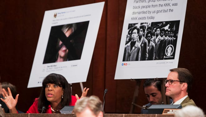 Rep. Terri Sewell, D-Ala., left, with Rep. Jim Himes, D-Conn., right, questions Facebook's General Counsel Colin Stretch on the role the company's lack of diversity played in the spread of racist messages by fake Russian accounts.