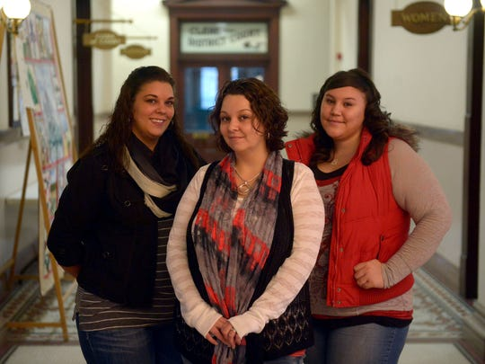 Savannah Hilton, left, Nicole Griffith, center, and Lacey Racine of the Victim-Witness Assistance Services.