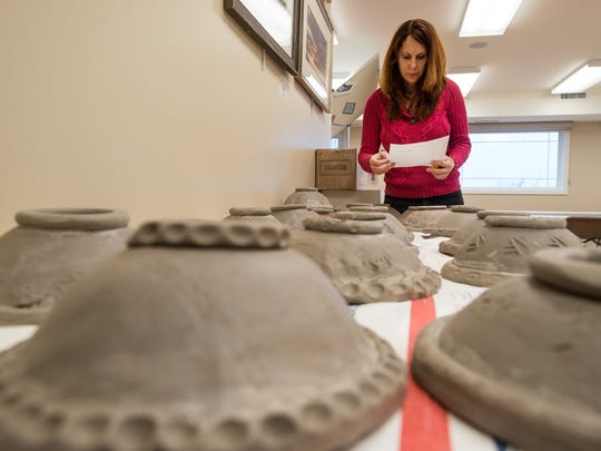 Ocean City Art League Assistant Ceramics Director Nancy Barnas organizes bowls that were completed Saturday.