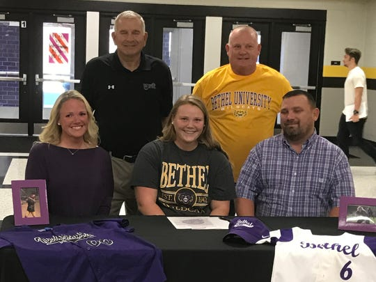 Hendersonville High senior Annsley Kalamon (seated, center) recently signed her letter of intent to continue her education and softball career at Bethel University.