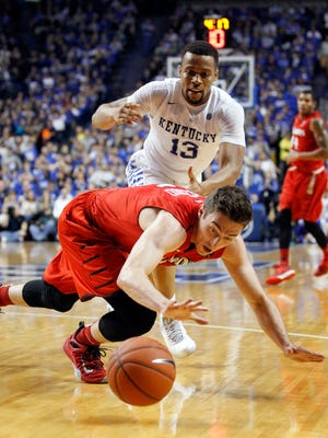 Nov 30, 2015; Lexington, KY, USA; Illinois State Redbirds guard Justin McCloud (15) and Kentucky Wildcats guard Isaiah Briscoe (13) dive for a loose ball in the first half at Rupp Arena. Mandatory Credit: Mark Zerof-USA TODAY Sports