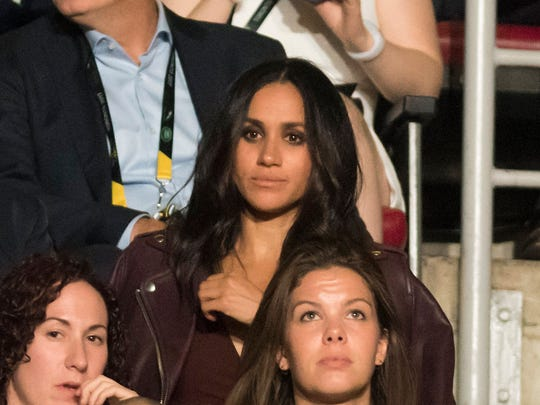Meghan Markle watches the opening ceremonies of the