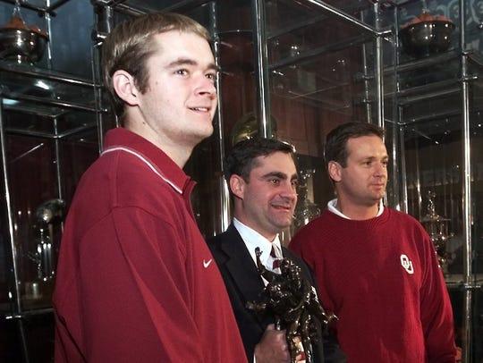 Oklahoma quarterback Josh Heupel, left, and coach Bob