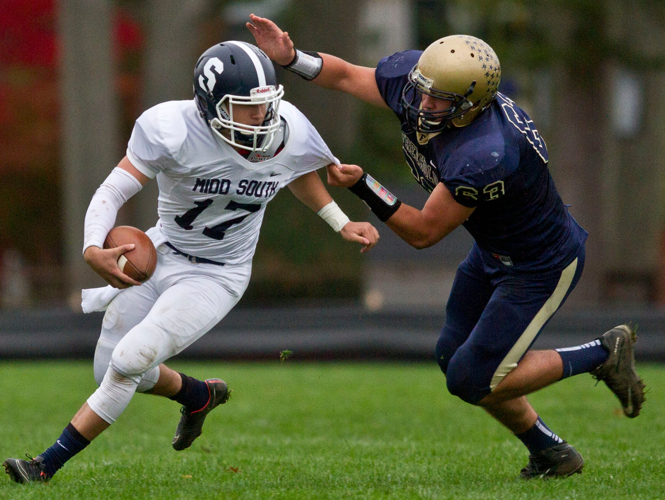 Middletown South's Matt Mosquera (17) is sacked by Freehold's Todd Burger. Middletown South at Freehold football. Freehold, NJ Saturday, November 7, 2015 @dhoodhood