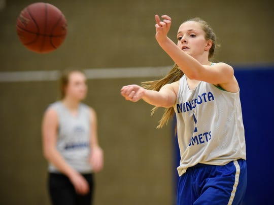 Sartell's Alexie Winter takes part in a passing drill Tuesday, March 7, during practice at Sartell High School.