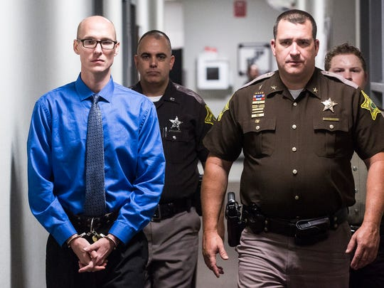 Danny Saintignon Jr. is taken to Circuit Court 3 by Sheriff Ray Dudley at the Delaware County Justice Center in this file photo from 2017.