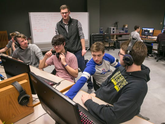Noah Hankinson (top), a coach, monitors students through eSports game League of Legends during after school practice at Noblesville High School, Noblesville, March 5, 2018. ESports are growing, and large arenas have been filled with spectators to watch matches.