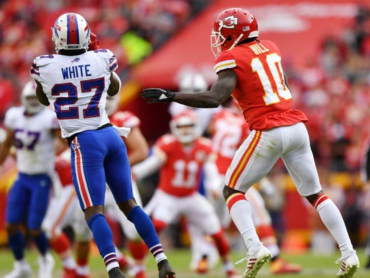 Buffalo Bills cornerback Tre'Davious White comes up with the game-clinching interception in front of wide receiver Tyreek Hill during the fourth quarter of the Bills' 16-10 win Sunday at Arrowhead Stadium. Peter Aiken/Getty Images