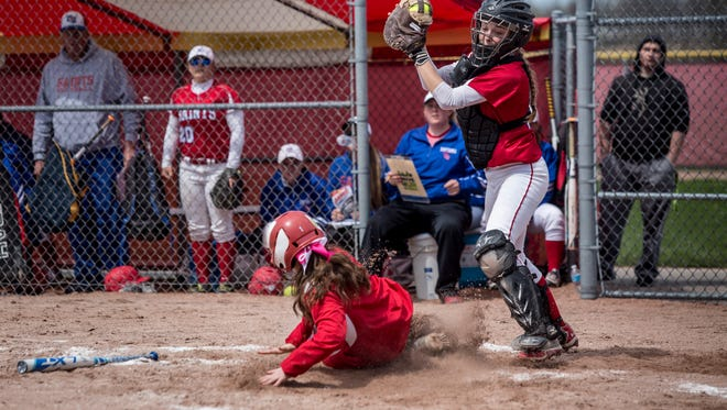 St. Clair's Alexa Rutledge is late to the tag on Anchor Bay's Felicia Maximiux during a softball game Saturday, April 22, 2017 at Anchor Bay High School.