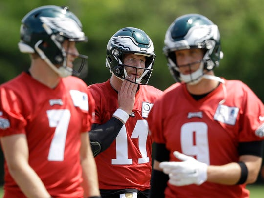 Philadelphia Eagles' Carson Wentz (11), Nick Foles (9), and Nate Sudfeld (7) walk to the next drill during an organized team activity at the NFL football team's practice facility, Thursday, June 7, 2018, in Philadelphia.