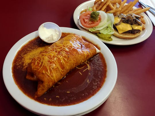 The enchilada and a mushroom cheeseburger served at Spud's in Chester.
