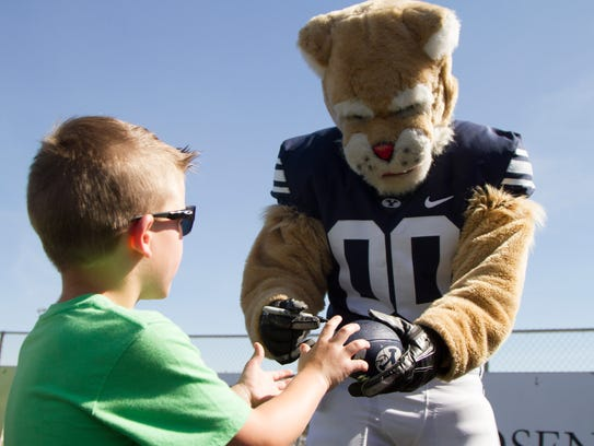 The BYU football team meets with fans and practices