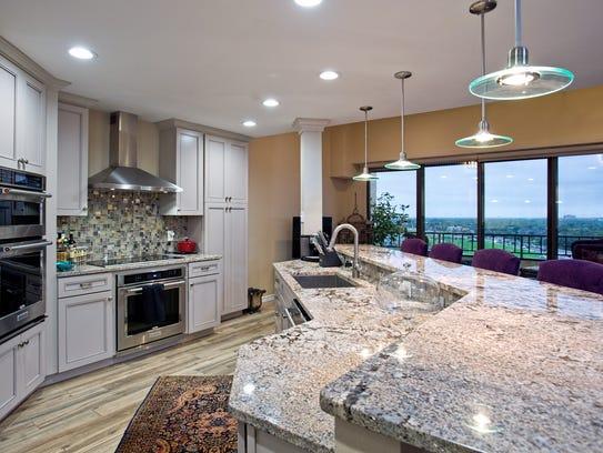 The gourmet kitchen  features beautiful granite countertops,