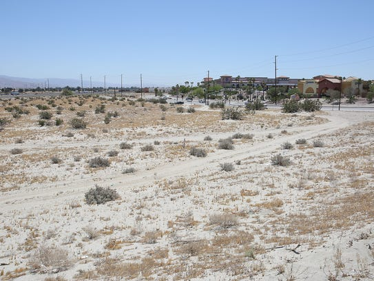 An empty lot near i 10 will be home to a hotel drive thru for Desert motors palm desert