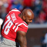 Mississippi offensive lineman Laremy Tunsil (78) encourages a teammate during warmups prior to their NCAA college football game against Vanderbilt, Saturday, Sept. 26, 2015, in Oxford, Miss. Tunsil has yet to play for the Rebels this season. (AP Photo/Rogelio V. Solis)