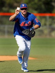 New York Mets catcher Kevin Plawecki runs with a ball
