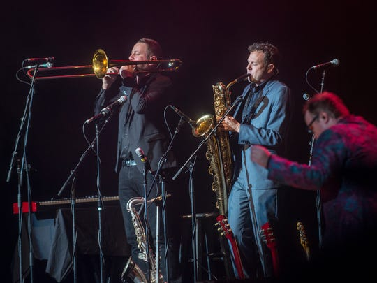Chad Fisher, left, of Deatsville plays trombone and