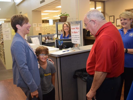 Kay Michiels (left), with her grandson Baylor Fall, talks with Woodworth mayor David Butler as they both wait at the Rapides Parish Clerk of Court's office Wednesday, July 10, 2018 waiting to qualify for upcoming elections. Michiels will be running for mayor of Alexandria and Butler will rerun for mayor of Woodworth.