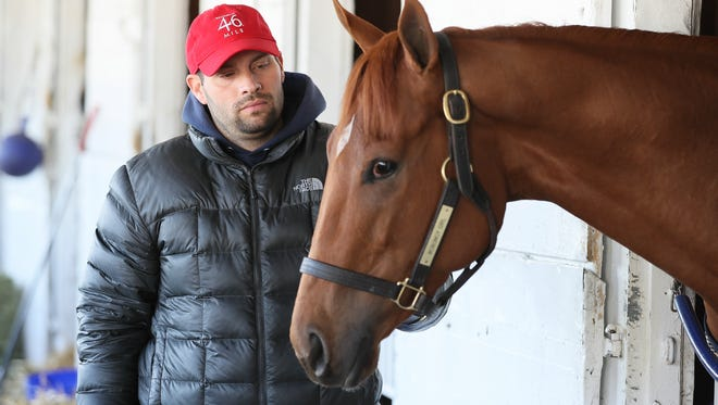 Trainer Brad Cox with Monomoy Girl who is entered in the Kentucky Oaks.