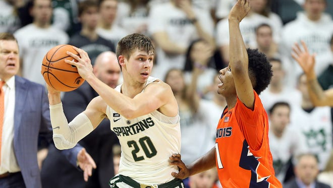 Michigan State's Matt McQuaid looks to pass during the first half on Tuesday, Feb. 20, 2018, at Breslin Center.