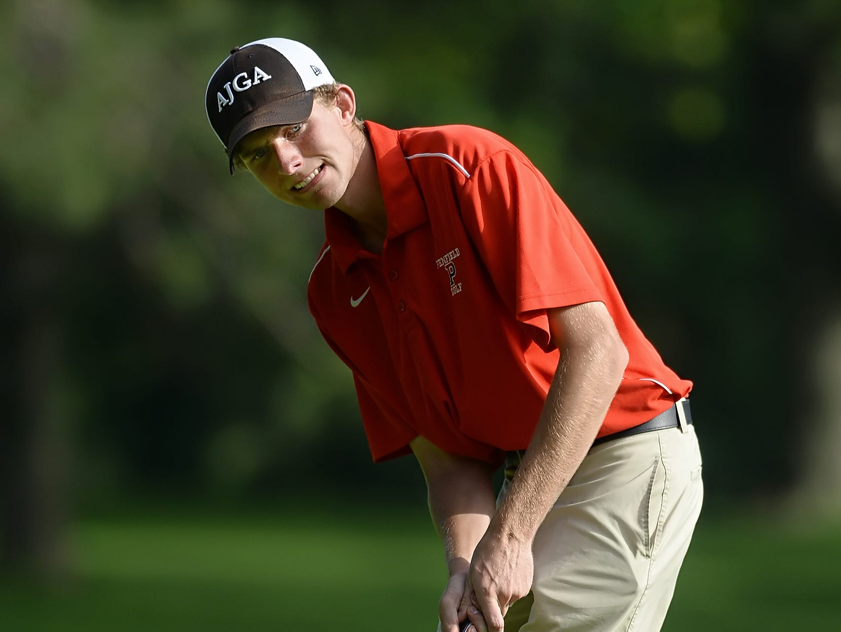 Penfield's Zak Ottman rolls a putt on the 12th green during the 2015 Section V SuperSectionals.