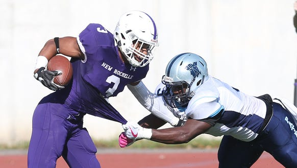 New Rochelle's Myles Taylor (3) tries to get away from