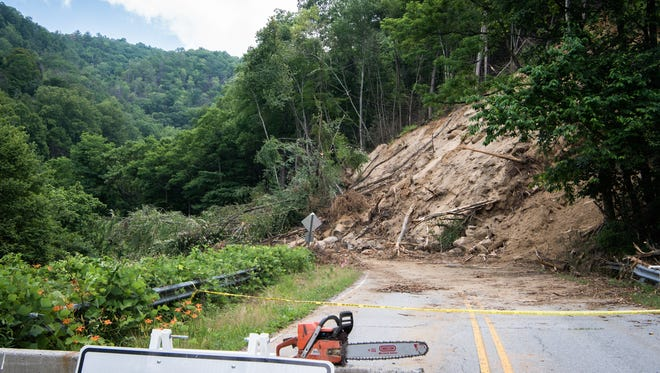 A landslide covered a 100-foot stretch of N.C. 9 near Bat Cave earlier this month. Workers hope to reopen one lane of the road Friday.