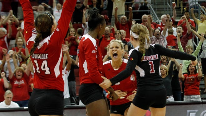 University of Louisville volleyball team celebrates after defeating the University of Kentucky their volleyball match at the KFC Yum! Center in Louisville, Kentucky.      August 29, 2012