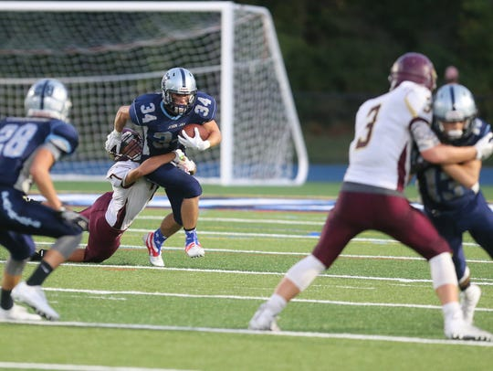 Arlington defeats John Jay 13-7 in football action
