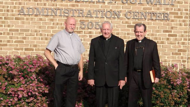 The St. Joseph Parish Administration Building was officially named the Father Joseph F. Gotwalt Administration Center, in honor of its former pastor, after the 5 p.m. Mass on June 25. From left, are Deacon Tom Aumen, Father Joseph Gotwalt and Monsignor James Lyons.