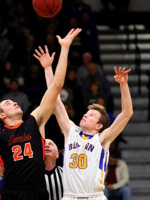 Nathan Michels tips the ball in BC boys' basketball action against West Delaware.